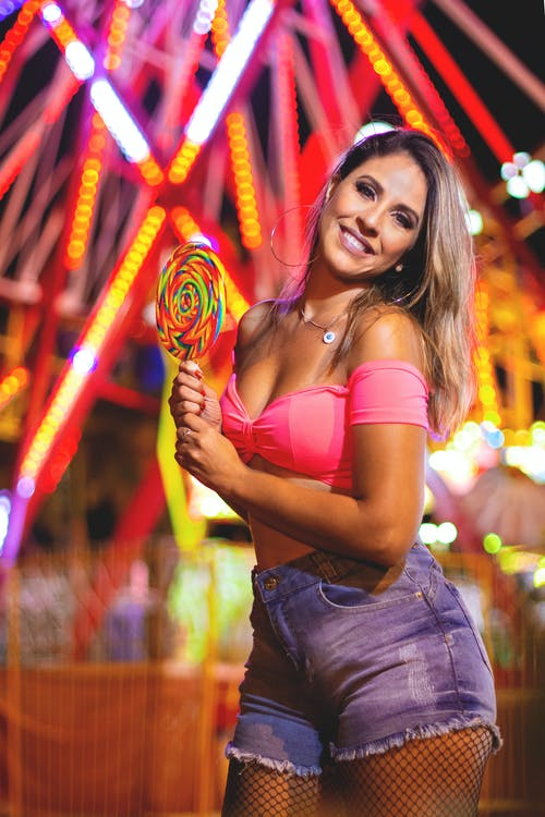 Photo Of Woman Holding Lollipop