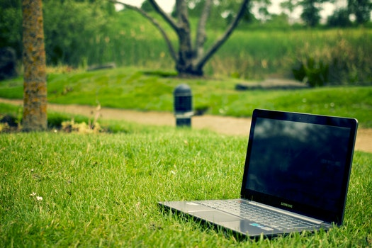 Free stock photo of laptop, notebook, grass, meadow