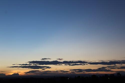 Foto profissional grátis de pôr do sol-nuvens-foto