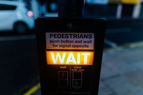 Yellow Wait Signage