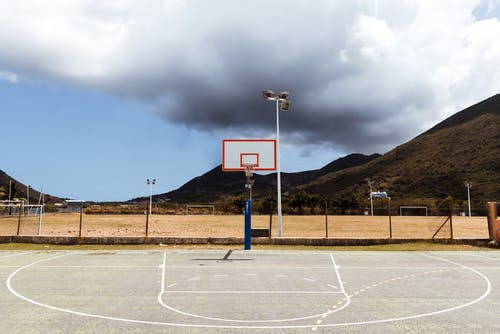Photo of Basketball Court Under Cloudy Sky