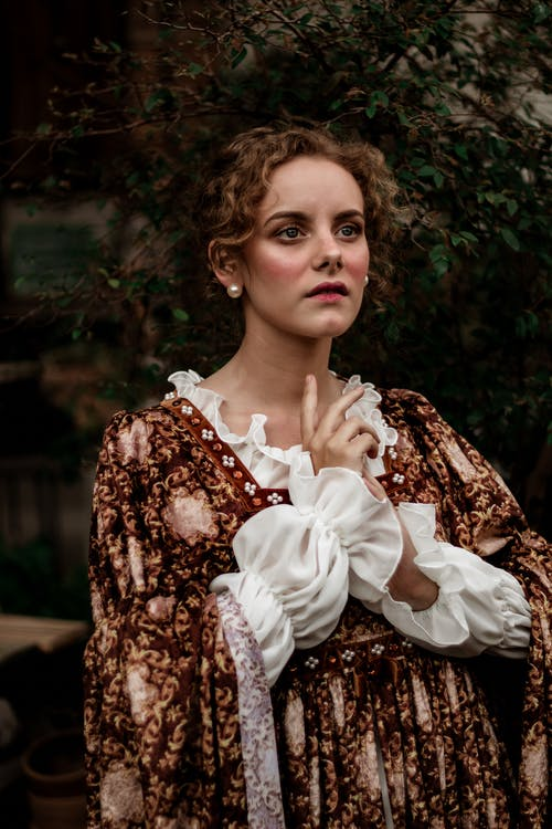 Woman Wearing White and Brown Floral Ruffled Victorian Dress