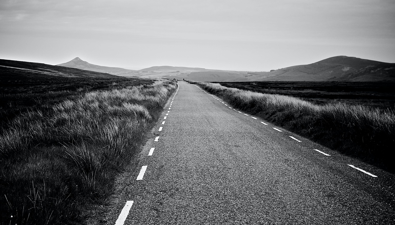 Asphalt Road Between Grass Field