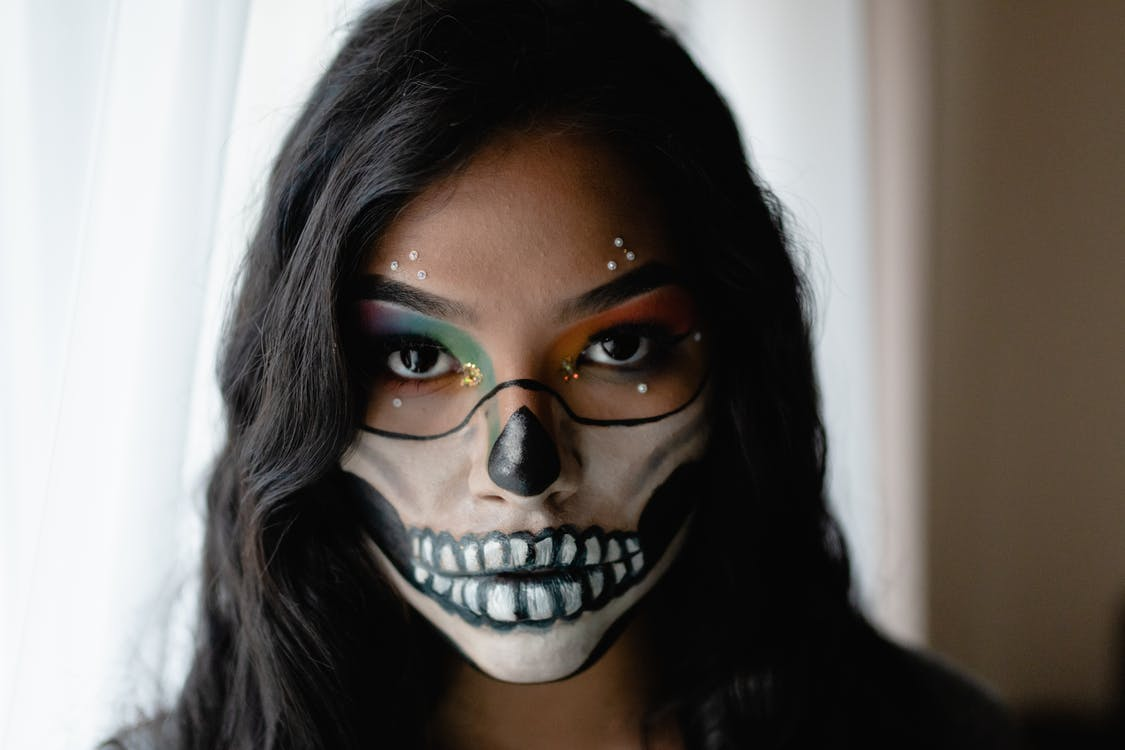 Shallow Focus Photo of Woman With Face Paint