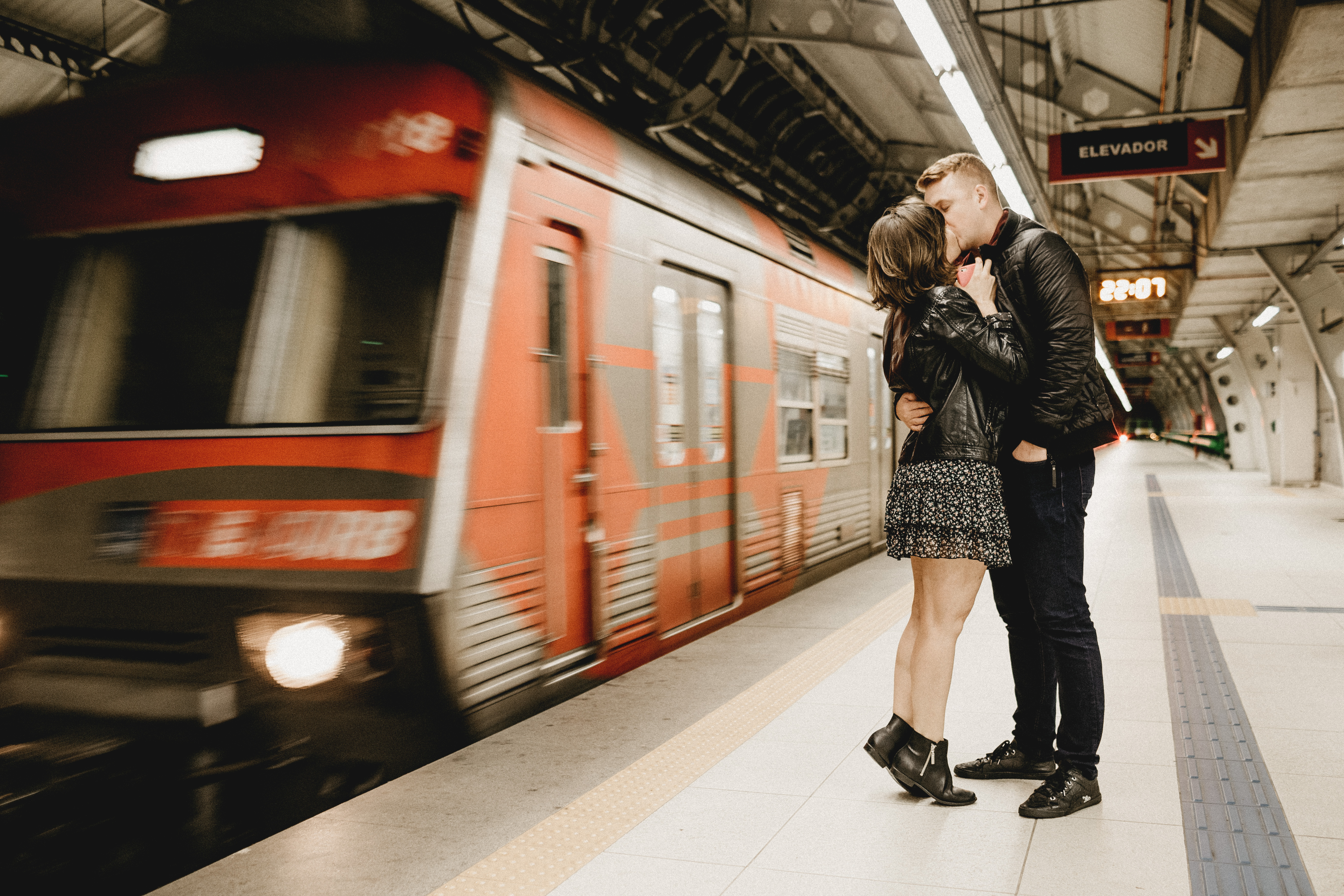 Kissing Couple Beside Running Train in Subway