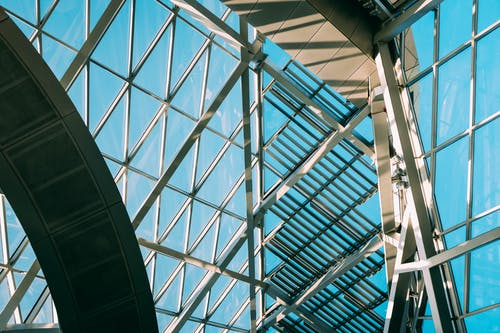 Low Angle Shot From Inside Of A Modern Building With Steel And Glass Panels Exterion
