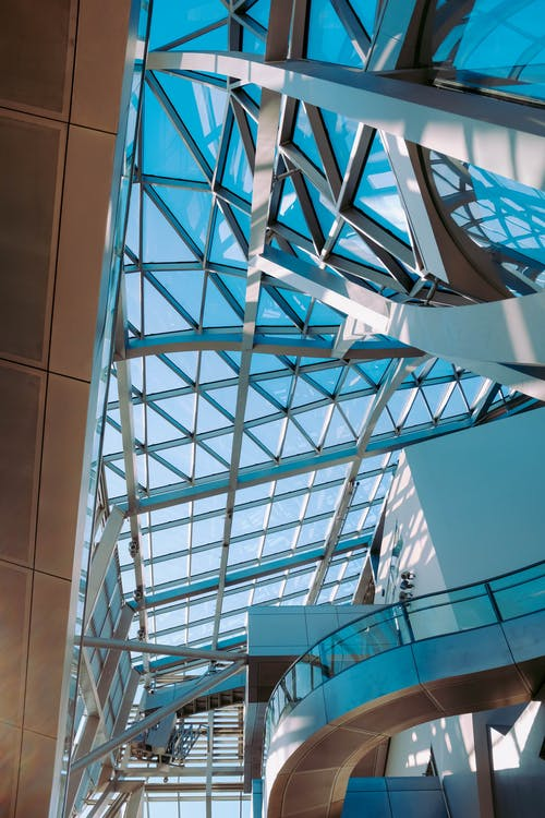 Low Angle Shot Of A Modern Building With Steel And Glass Panel Ceiling