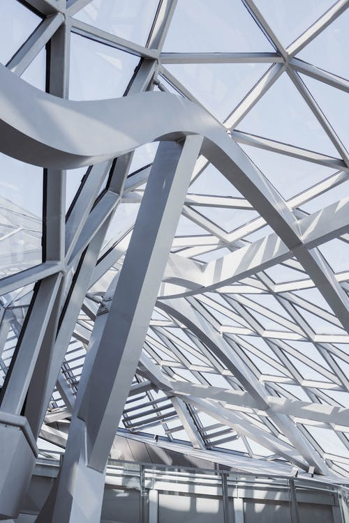 Close-up Of The Steel Frame Structure And Glass Panels With Geometric Design Of A Modern Building Interior