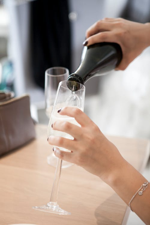 Person About to Pour the Bottle in to Wine Glass