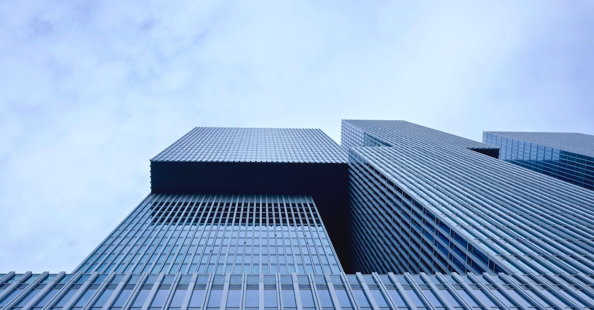 Low Angle Photography Of Building Free Stock Photo: Low Angle View Of Office Building Against Sky · Free Stock