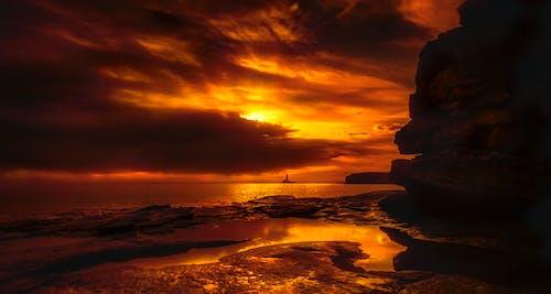 Foto Des Meeres Unter Orange Himmel
