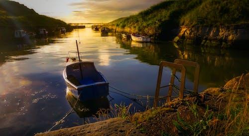 Blue Wooden Boat in Body of Water