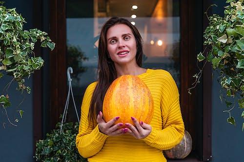 Woman Holding Pumpkin
