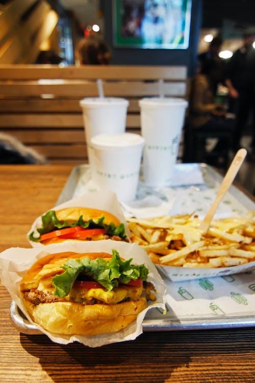 Hamburgers and Potato Fries on Tray