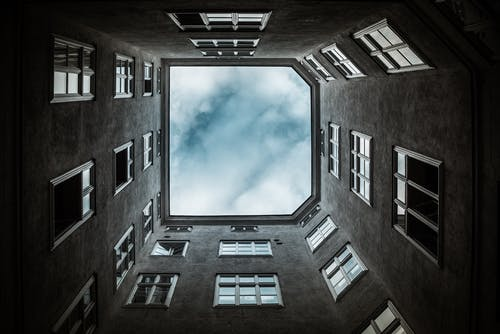 Low Angle Photo of Building Under Clouds