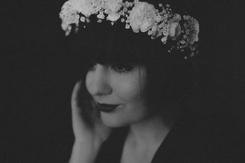 Grayscale Photo of Woman Wearing Floral Headband