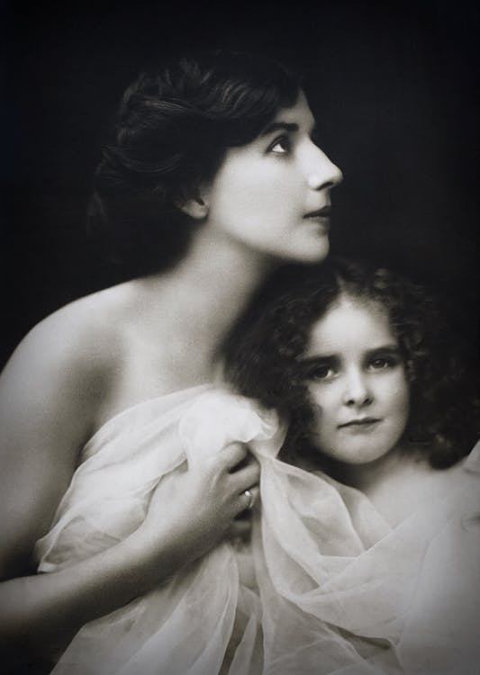 Monochrome Photo of Mother and Child