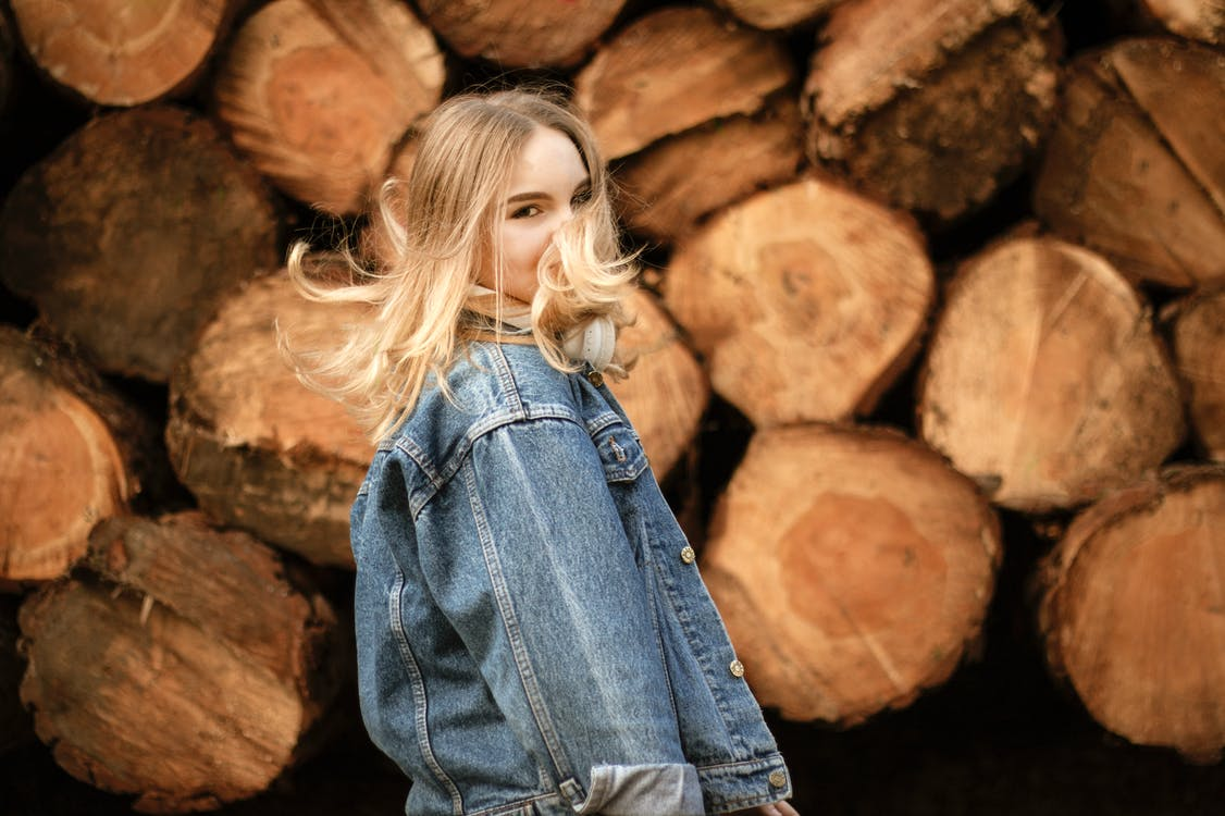Shallow Focus Photo of Woman in Blue Denim Jacket