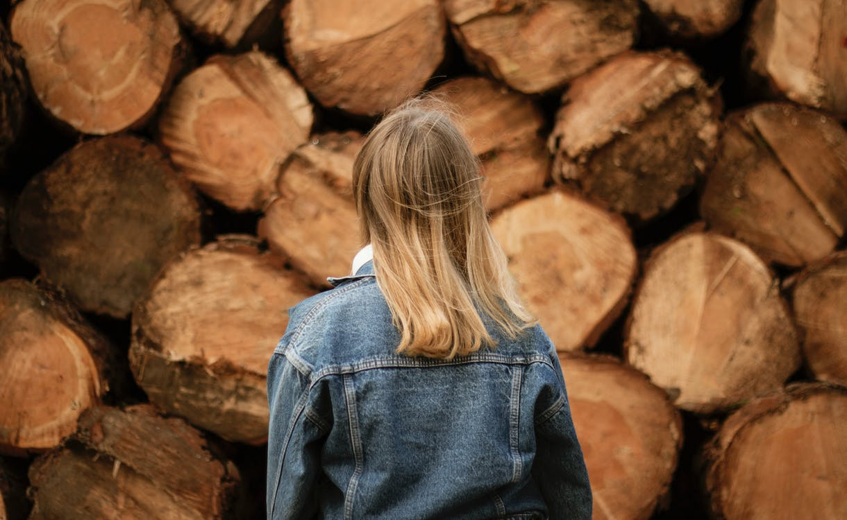 Woman In Denim Jacket in Front Logs