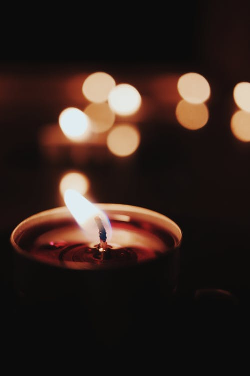 Close-Up Photo of Lighted Candle
