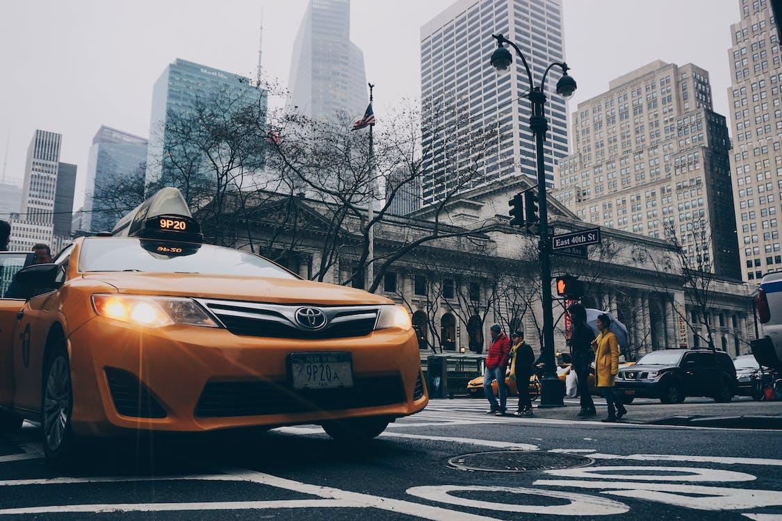 Yellow Toyota Sedan on in Highway Road