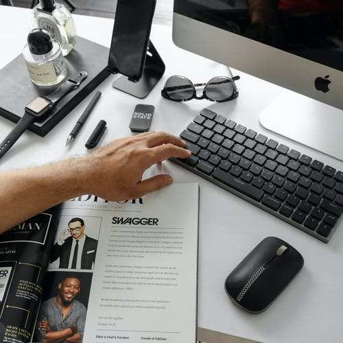 Black Wireless Keyboard Beside Mouse