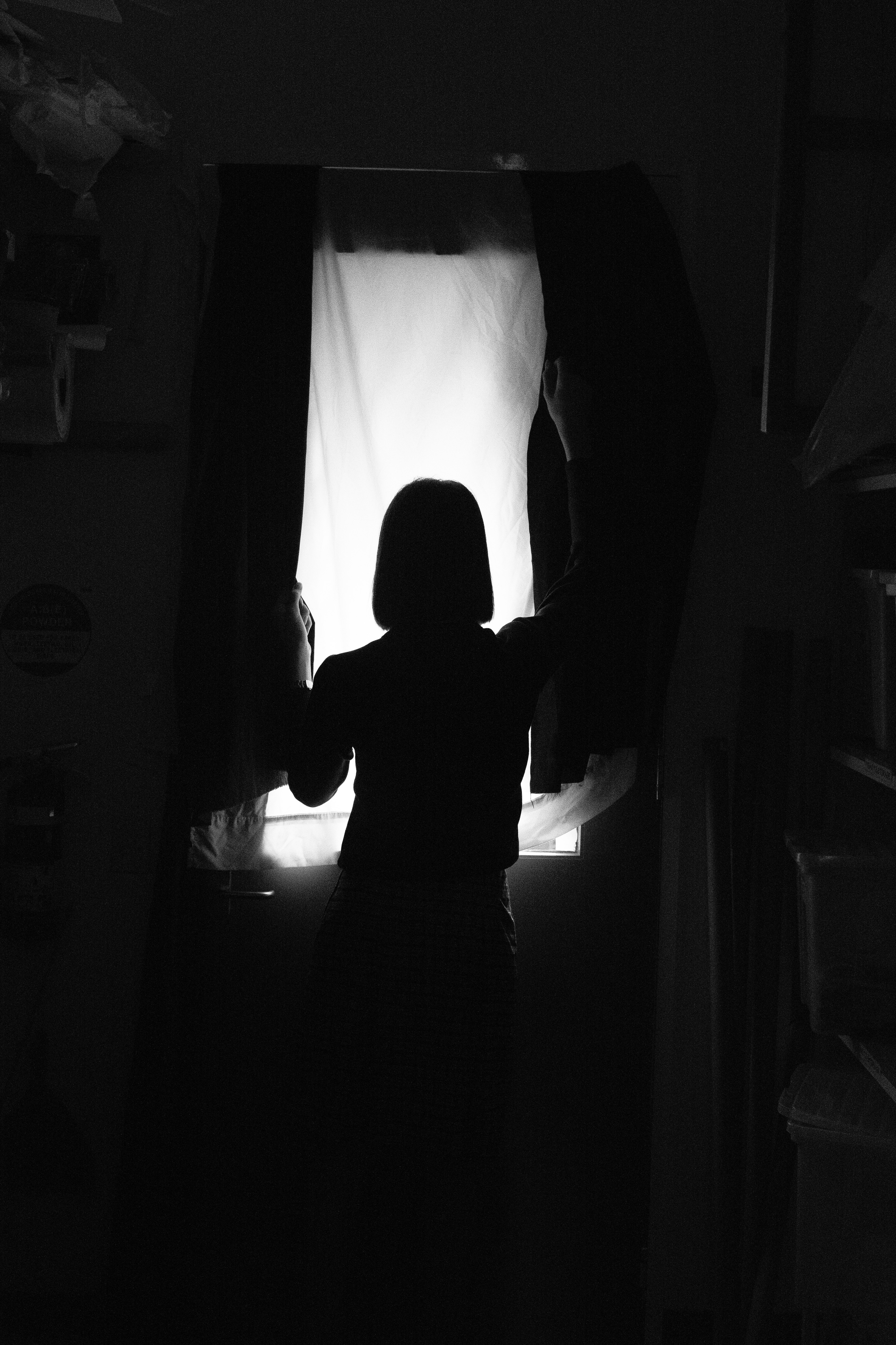 Silhouette Photo Of Person Standing In Front Of Window Free Stock Photo