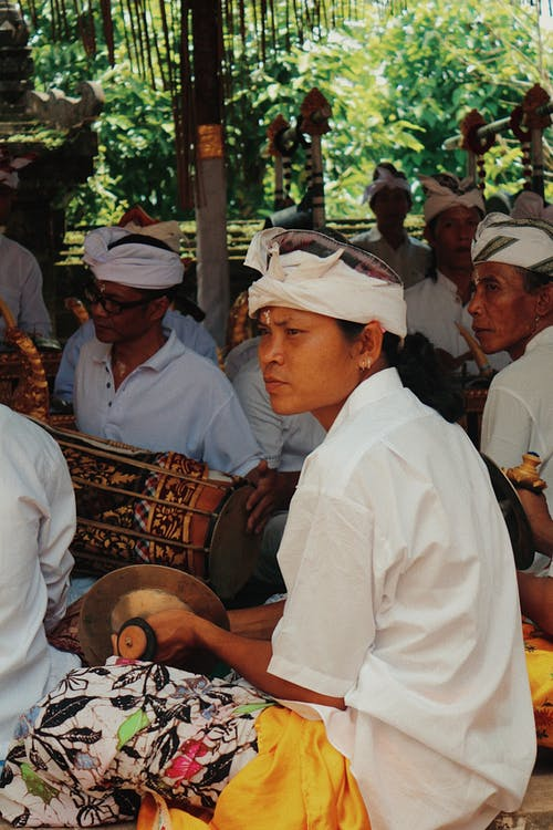 people sitting Holding Instruments