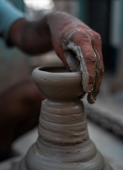 Person Molding a Clay Pot