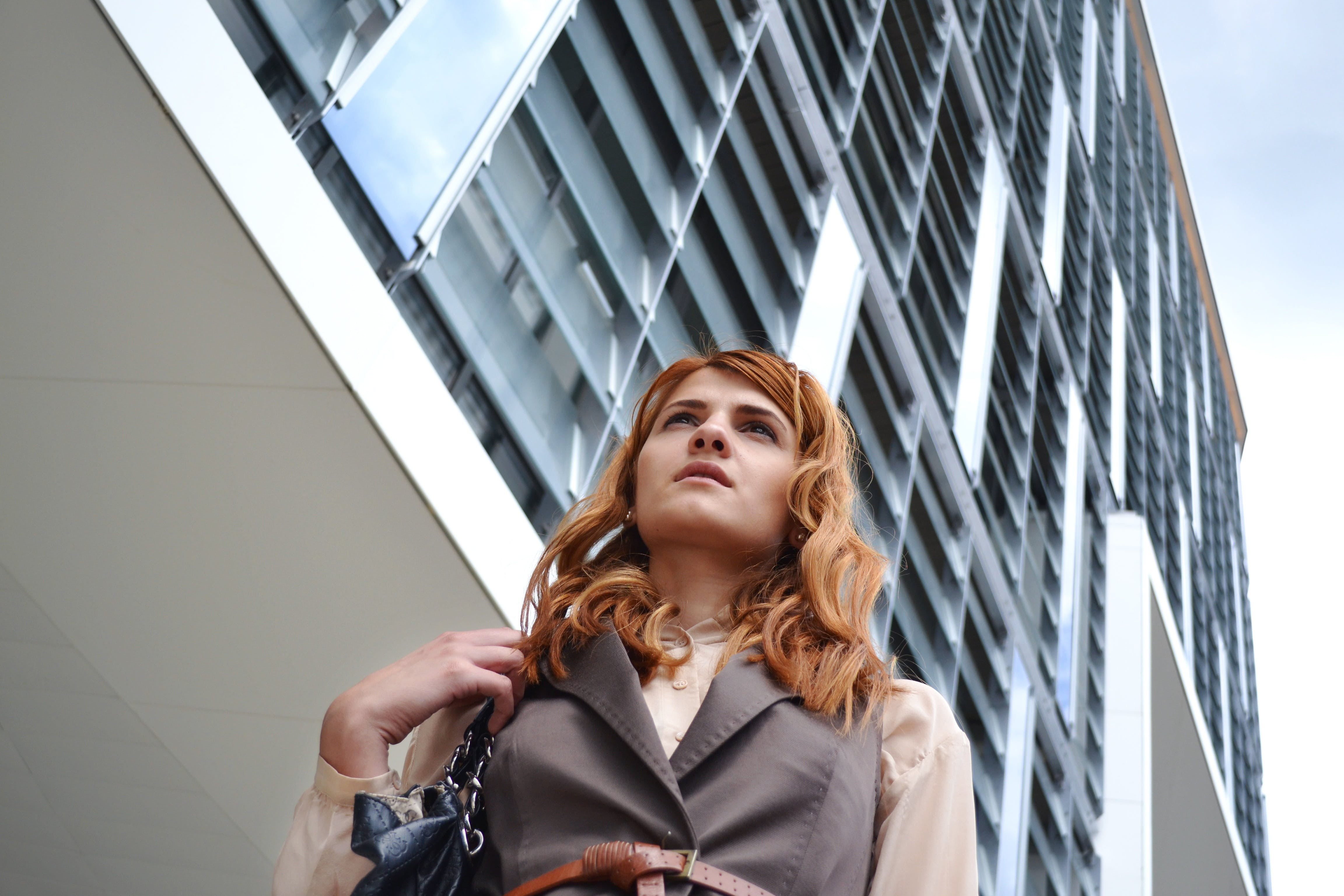 Woman Looking at Modern Office Building