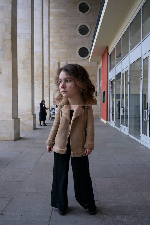 Woman in Brown Jacket and Black Pants