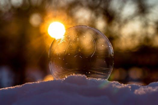 Defocused Image of Sun Reflecting in Water