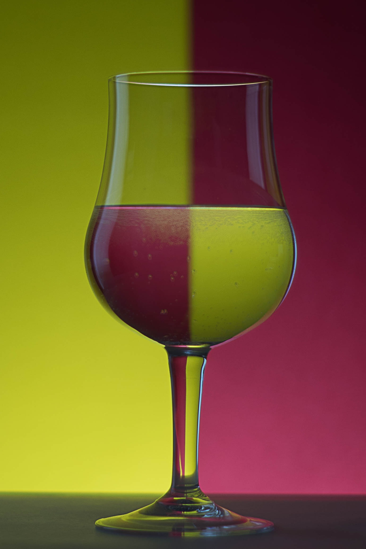 Close-up of Beer Glass Against Colored Background