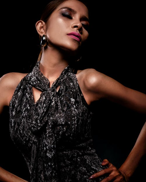Woman Wearing Black Halter-Top Dress