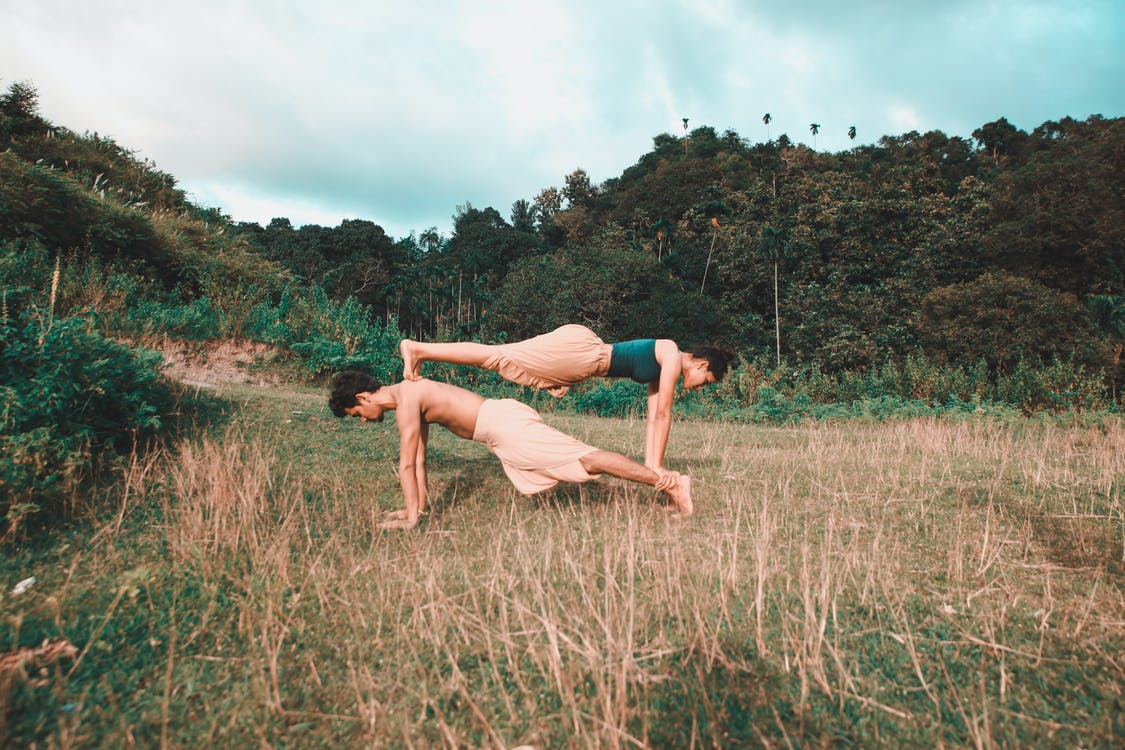 Coupe Doing Yoga