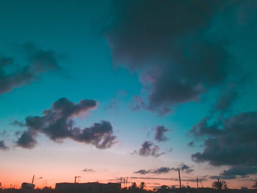 Free stock photo of clouds, colors, downtown, sunset