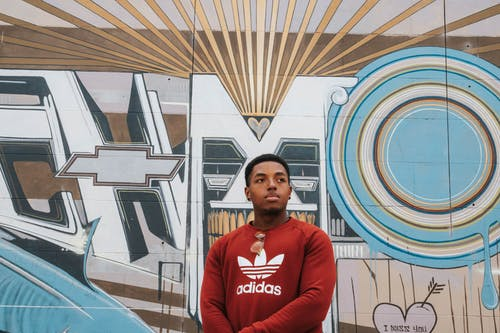 Man Wearing Red Adidas Crew-neck Sweater