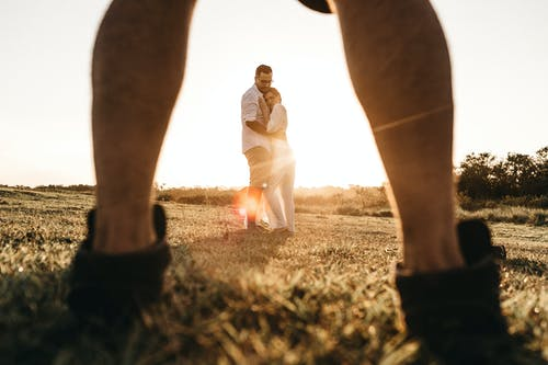 Couple in Grass Field