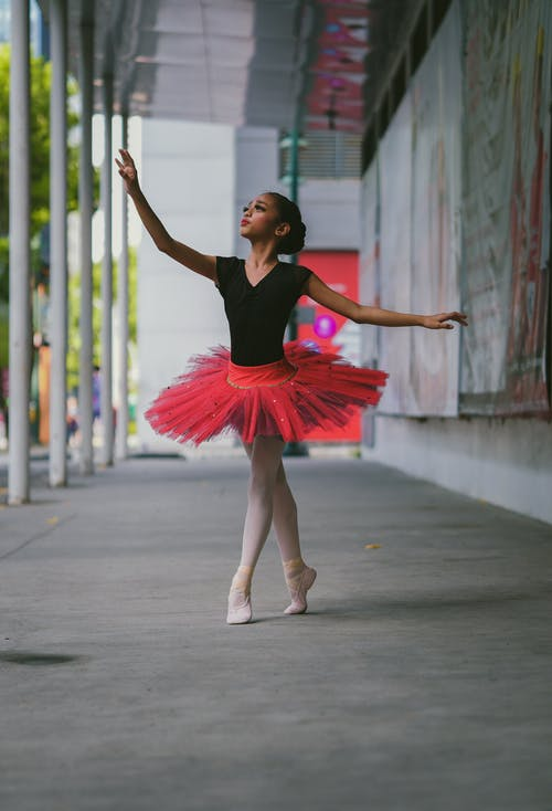 Ballerina Wearing Red Tutu Skirt
