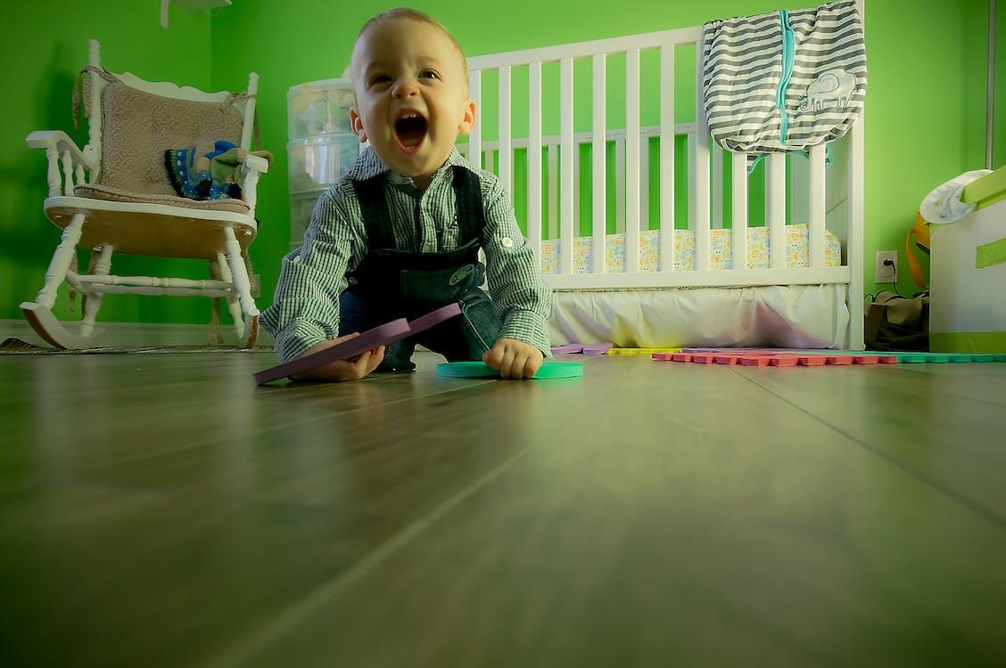 Full Length of Boy Sitting on Floor