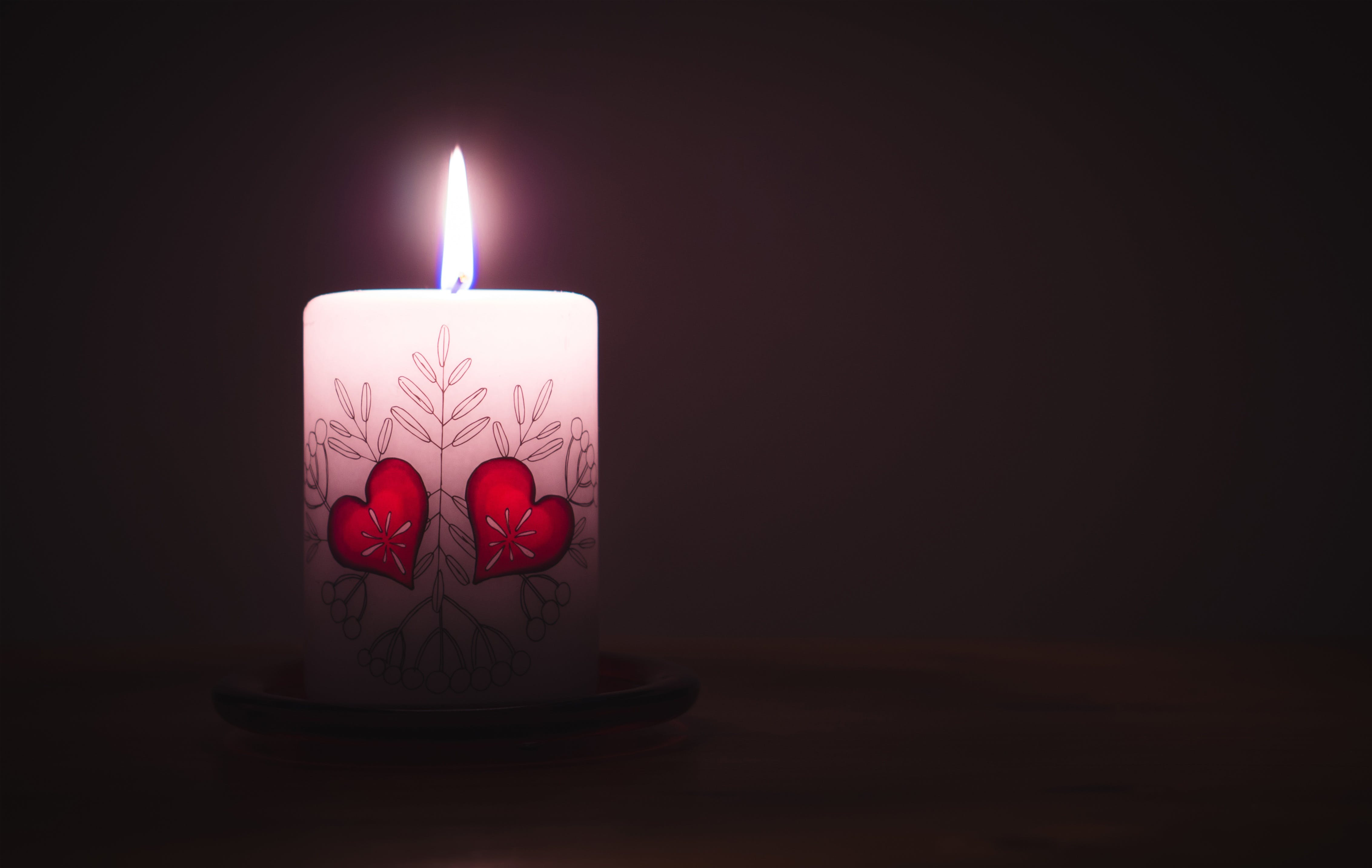 Close-up of Illuminated Candle Against Black Background