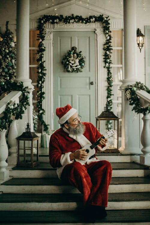 Man In Santa Claus Costume sitting  on The door way