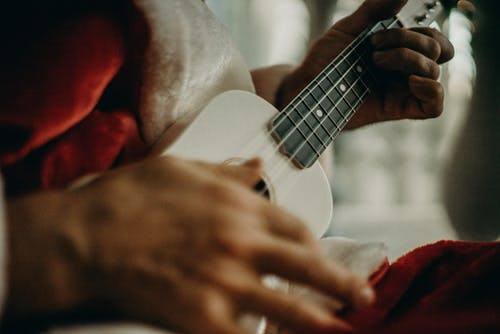 Person Playing The Ukelele