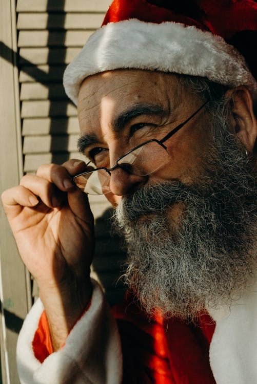 Close Up Photo of a Man Wearing Santa Costume