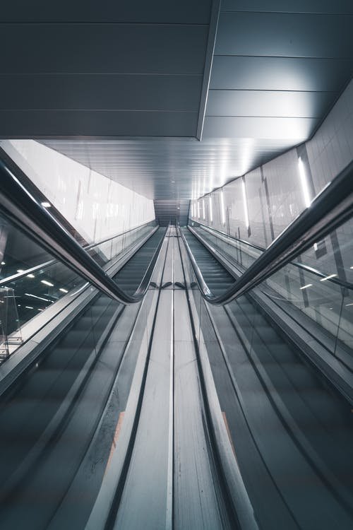 Low Angle Photography of Empty Escalators