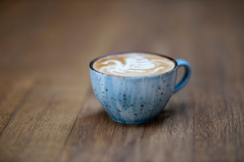 Blue Ceramic Coffee Cup on Brown Wooden Surface