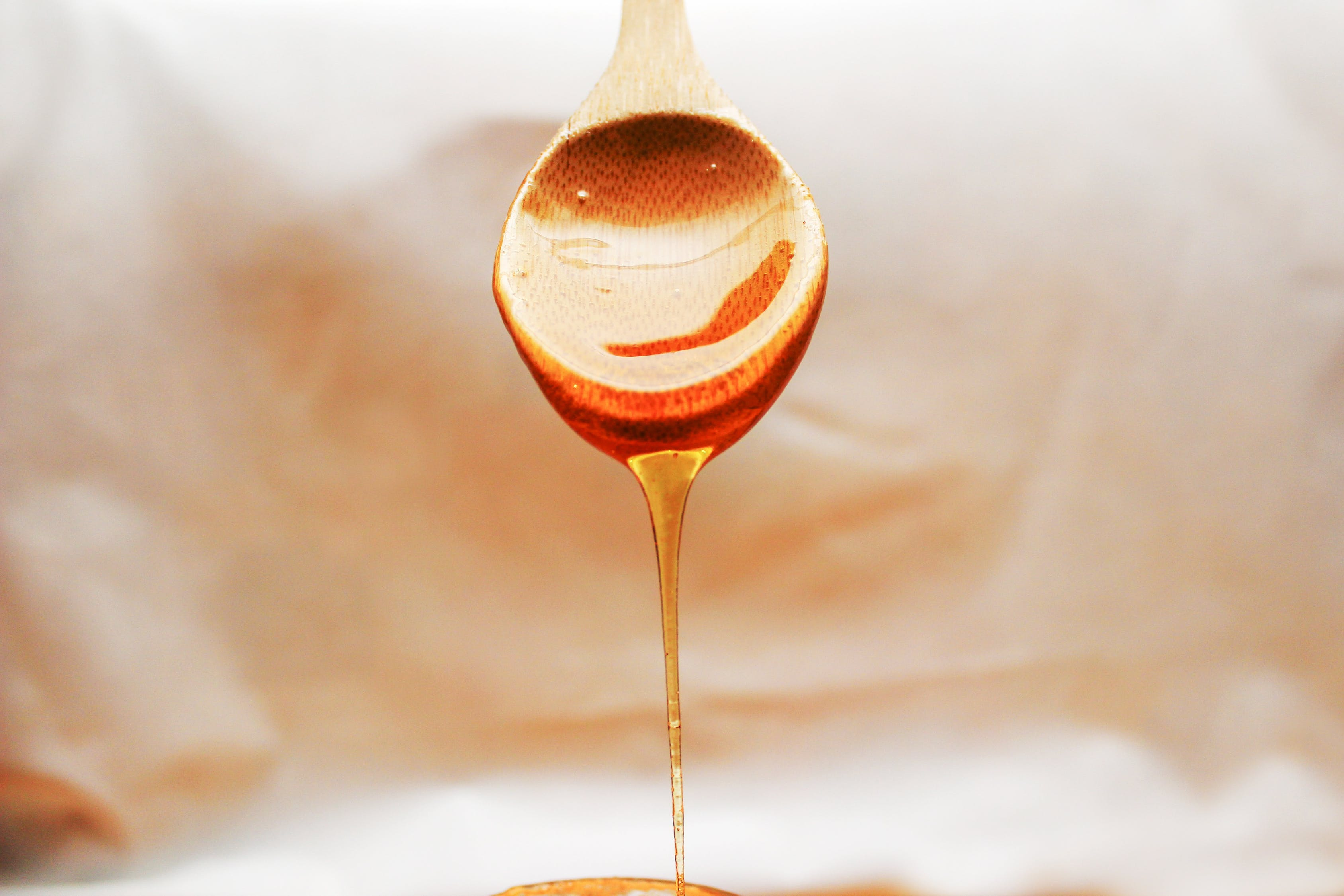 honey pouring from a spoon