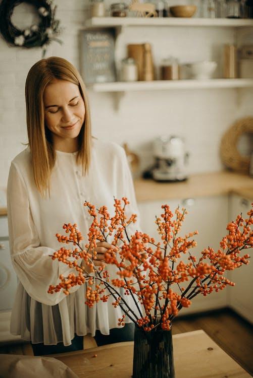 Woman Fixing Flowers