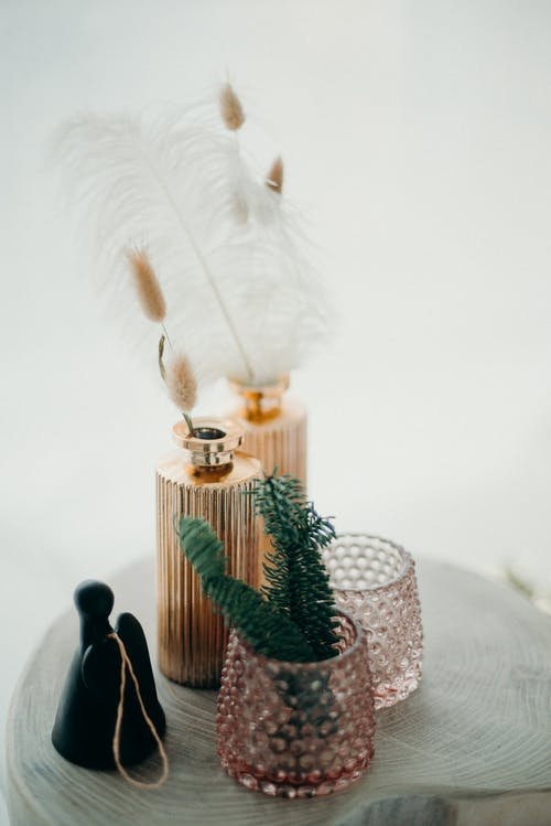 White Feather on Fragrance Bottle