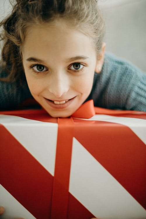 Girl With A Red and White Striped Gift Box
